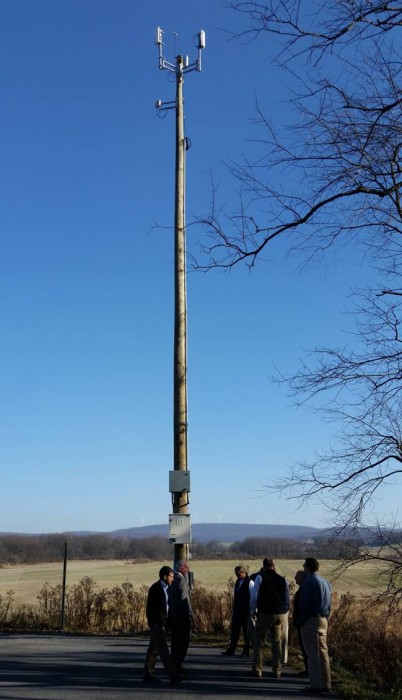 [A community mast (wooden pole) with wireless equipment]